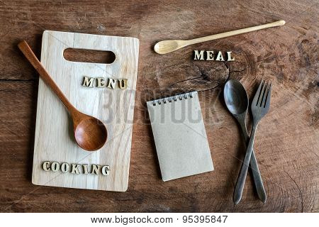 Wooden Spoon And Fork With Note On Old Wooden Textured