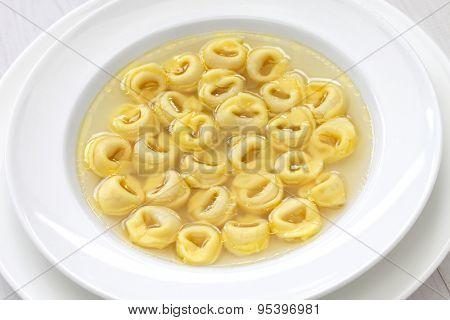 tortellini in brodo, ring shaped pasta in broth, italian emilia romagna soup cuisine