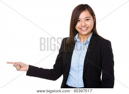 Businesswoman pointing aside for direction