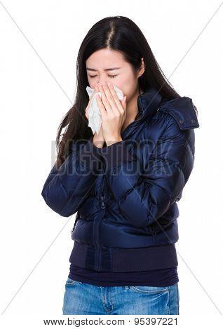 Woman feeling unwell and sneeze