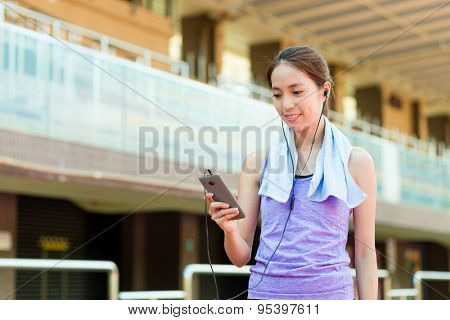 Woman enjoy the music with doing exercise
