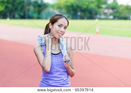 Woman using towel after doing exercise