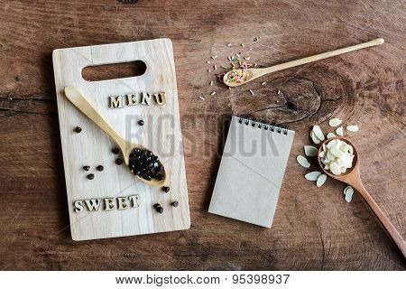 Wooden Spoon And Fork With Note On Old Wooden Background