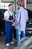 picture of car repair shop  - Young man leaving car at repair shop - JPG