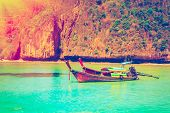 pic of phi phi  - Traditional wooden boat in a tropical bay on Koh Phi Phi Island - JPG
