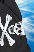 stock photo of pirate flag  - Pirate waving flag on a beautiful day - JPG