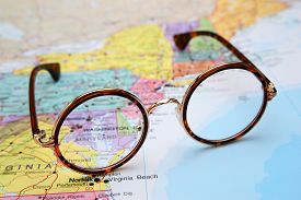 stock photo of maryland  - Photo of glasses on a map of USA. Focus on Maryland. May be used as illustration for traveling theme. ** Note: Soft Focus at 100%, best at smaller sizes - JPG