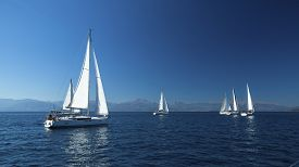 stock photo of yacht  - Ship yachts with white sails in the open Sea - JPG