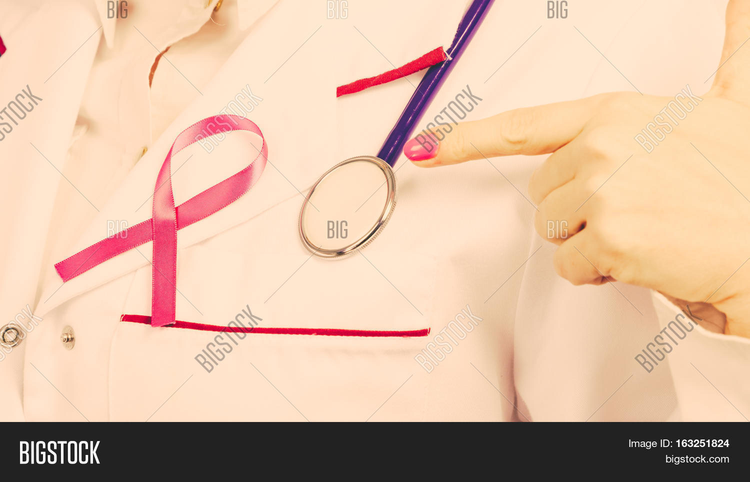 White apron health - Women Fight For Health Breast Cancer Tumor Concept Pink Ribbon And Blue Stethoscope On