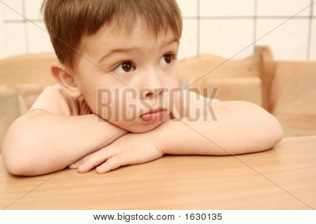 The Sight Of The Boy Which Lays On A Table