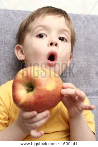 Emotions Of The Child Which Are Held In Hands With A Red Apple