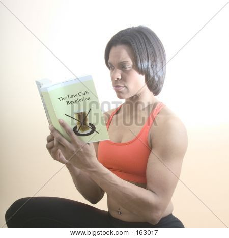 Fit Woman Reading A Diet Book