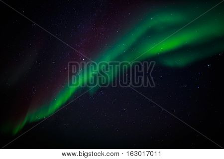 Green Northern Lights And A Starlight Sky Over Nuuk City, Greenland