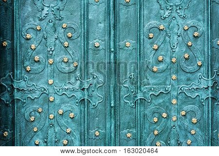Old wrought-iron gates. Blue door with a pattern.
