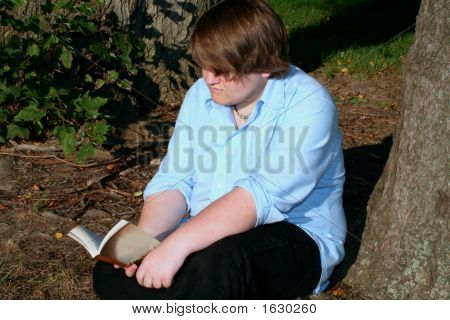 Teen Reading Outdoors