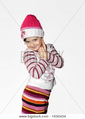 girl in fashionable cap on a white