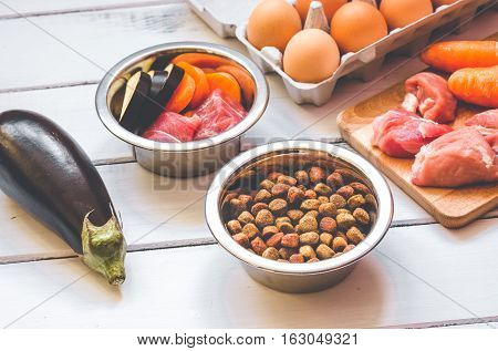 ingredients for pet food natural on wooden background close up