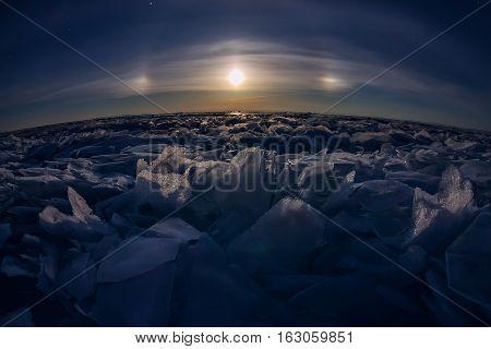 lunar halo of ice hummocks Lake Baikal.