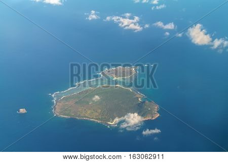 Aerial view of the Flat Island and Gabriel Island islands in the Indian Ocean governed by Mauritius. Pigeon House Rock is seen on the left.