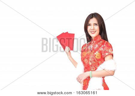 Beautiful Asian girl in Chinese qipao traditional dress holding red money pockets or greeting card envelopes Chinese new year concept isolated on white background