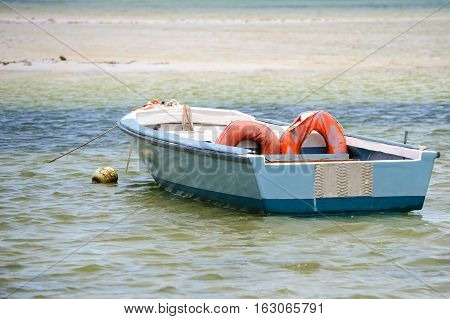 Rowboat Moored Near The Shore Of The Indian Ocean.