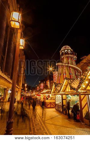 NOTTINGHAM ENGLAND - DECEMBER 22: Helter skelter and stalls at Nottingham Christmas market. In Nottingham England. On 22nd December 2016.