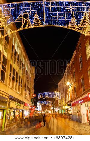 NOTTINGHAM ENGLAND - DECEMBER 22: People Christmas shopping Clumber Street Nottingham. In Nottingham England. On 22nd December 2016.