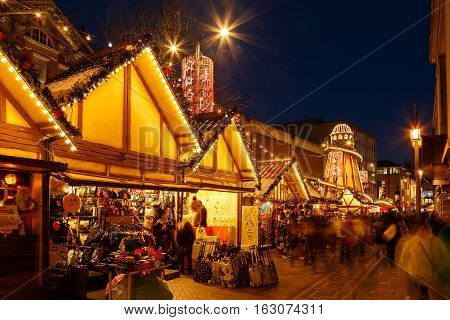 NOTTINGHAM ENGLAND - DECEMBER 22: Market stalls and helter skelter at Nottingham Christmas market. In Nottingham England. On 22nd December 2016.
