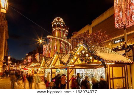NOTTINGHAM ENGLAND - DECEMBER 22: Nottingham Christmas market and helter skelter at night. In Nottingham England. On 22nd December 2016.