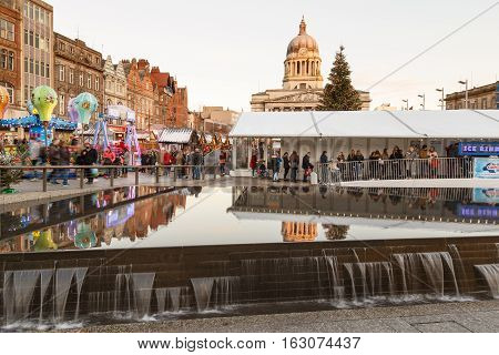NOTTINGHAM ENGLAND - DECEMBER 22: Various people at Nottingham Christmas Market and temporary ice rink. In Nottingham England. On 22nd December 2016.