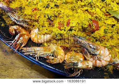 Paella with fish, shellfishes and shrimps in a street food festival in Trieste.