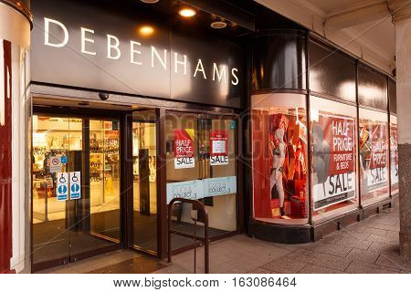 NOTTINGHAM ENGLAND - DECEMBER 26: Debenhams Nottingham on Boxing Day sales showing sales posters. In Nottingham England. On 26th December 2016.