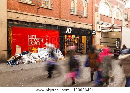 NOTTINGHAM ENGLAND - DECEMBER 26: Boxing Day sale starts at JD Sports shop in Nottingham. In Nottingham England. On 26th December 2016.
