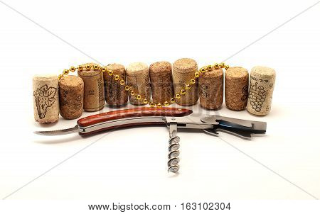 Corkscrew with few corks and and gold chain
