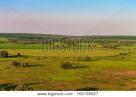 View green forest-steppe plain. Summer landscape from a height.