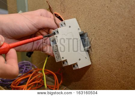 Electrician installing a surge switch - close-up remote switch