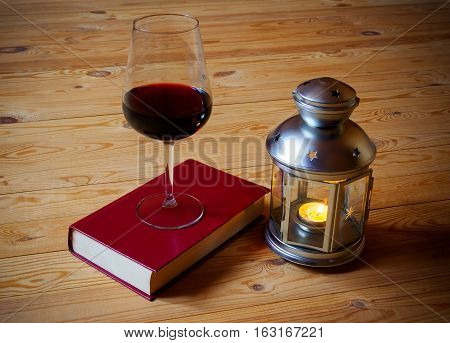 Wine book and lantern on wooden background