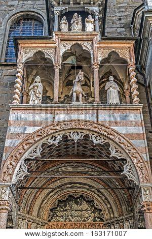 Part of facade from Basilica of Santa Maria Maggiore Cappella Coleoni Piazza Duomo Bergamo Alta Citta Italy. Romanesque architecture with a gilded interior hung with tapestries built in 1137.