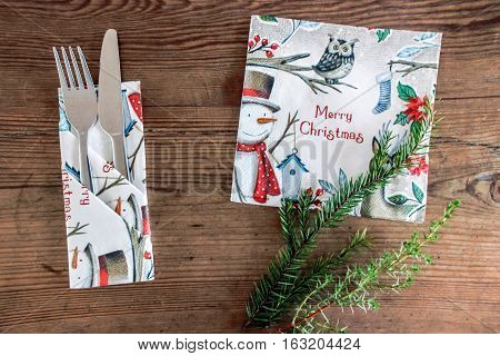 tableware and pine tree branches on table for christmas