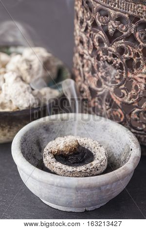 Copaifera officinalis resin burning on a hot coal. Copaifera (copaiba - bearer) is an aromatic resin, used for religious rites, incense and perfumes in Latin America