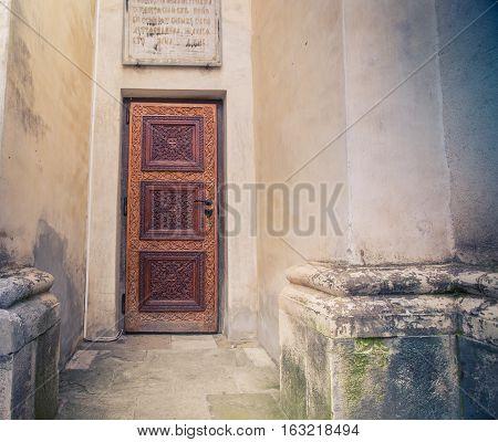Brown wood door on a building in brasov