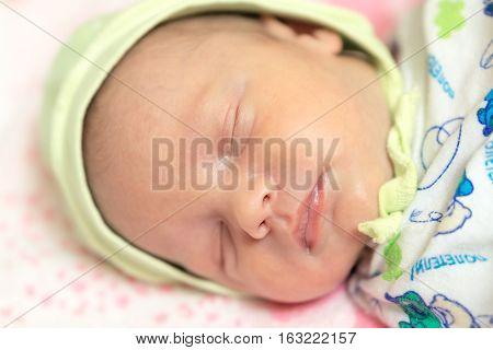 Cute Newborn Baby Sleeps In The Bed. Stock Photo