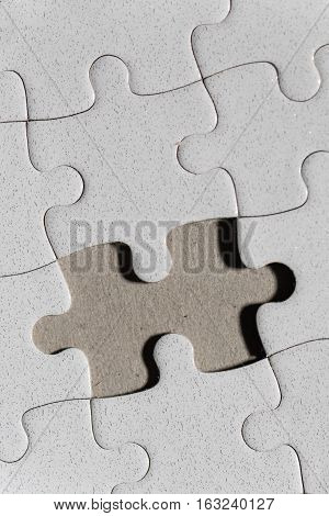 Blank white jigsaw puzzle and missing piece as copy space