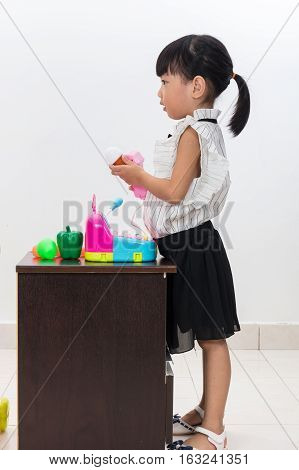 Asian Chinese Little Girl Pretending As Cashier With Toys