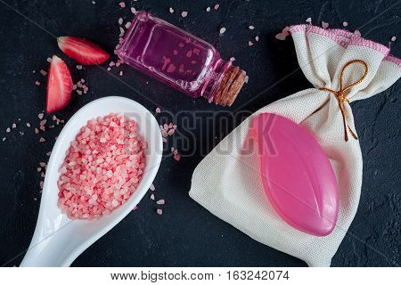 organic cosmetics with extracts of berries on dark background top view