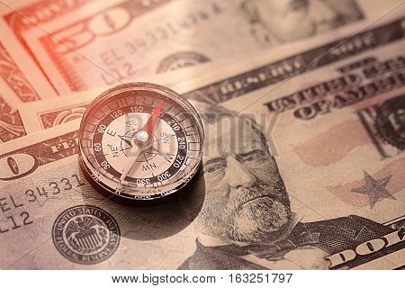 Compass on the banknote concept with the business plan of investment. Business plan for trader or investor by use the compass. Trader planning for use the money in invest.