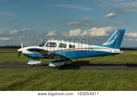 Single piston aircraft on the ground. Single-propeller aircraft at a small airport