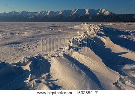Ice hummocks of Lake Baikal and the Holy Nose Peninsula.