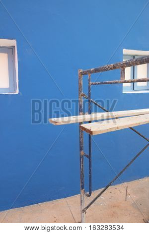 scaffolding in the construction with blue wall