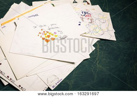 Big stack of mails pile of papers or heap of letters above a letter saying